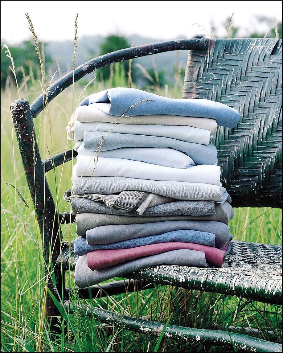 Stack of Shirts shot in a field